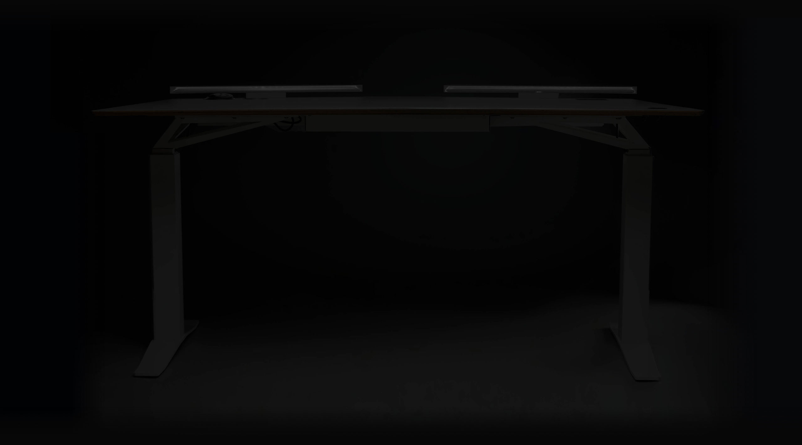 V-DESK Designer - The ultimate electric height adjustable standing desk with Lightbar, power outlets and a dedicated space for your monitor mount. Sit stand desk made in the UK.